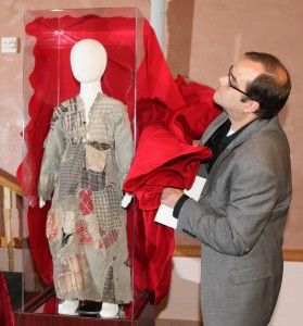 Kevin Blowers, Curator of Bethel College Library, unveiling the Orphan Dress from Hadjin