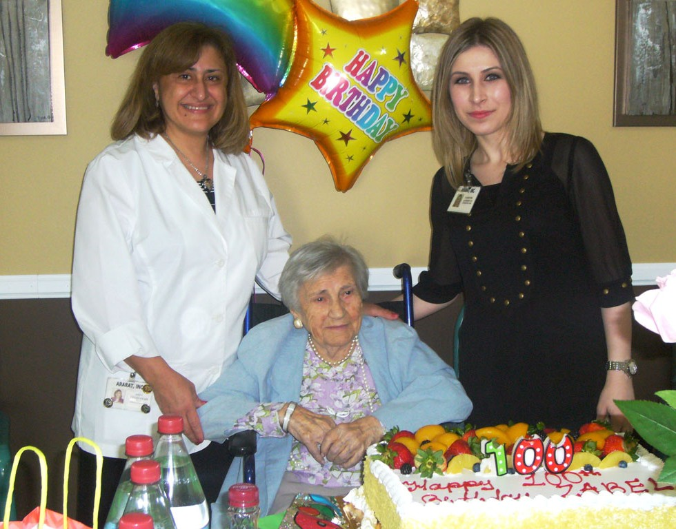1-Zabel-Krikorian-turns-100---Aida-Yeghiayan,-Director-of-Nursing,-and-Administrator-Varsenik-Keshishyan-congratulate-her