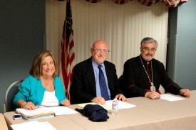 Bishop Mikael Mouradian with Board Chairman Joseph Kanimian and Board Secretary Nadya Verabian