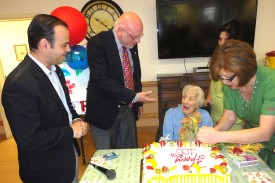 Mayor Zareh Sinanyan and Chairman Kanimian join the celebration of resident Alice Swaringen's 100th birthday at Ararat Nursing Facility
