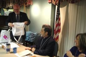 Board Chairman Joseph Kanimian gives the Primate a few Ararat Home memorabilia