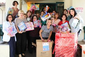 NF administration and staff celebrate a successful toy drive